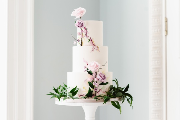 Minimalist wedding cake with pink rose decorations, shot at central London wedding venue