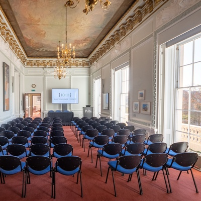 Conference layout in a grand room with theatre style seating and in built av facilities