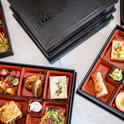 Buffet style lunch served in a box with individual compartments