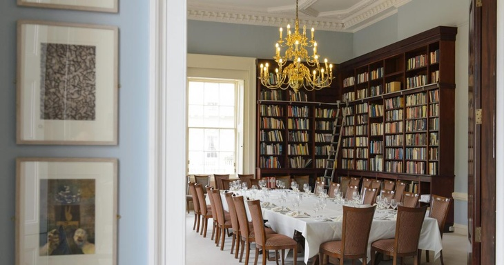 A boardroom meeting in the Library at 10-11 Carlton House Terrace, a historic London venue