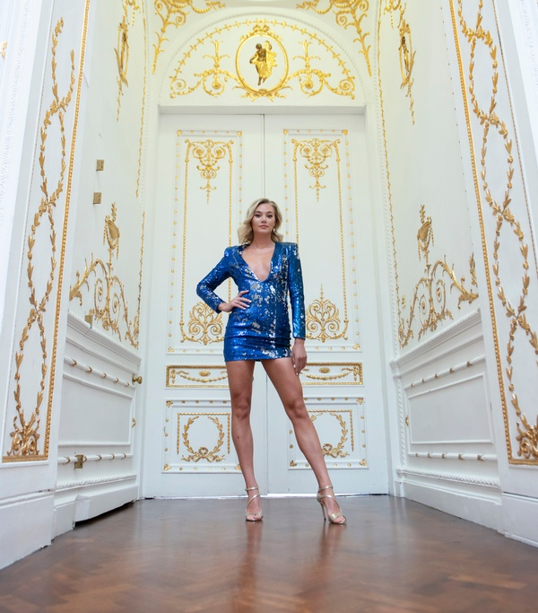 Woman in blue sequin dress at London photoshoot venue 10-11 Carlton House Terrace