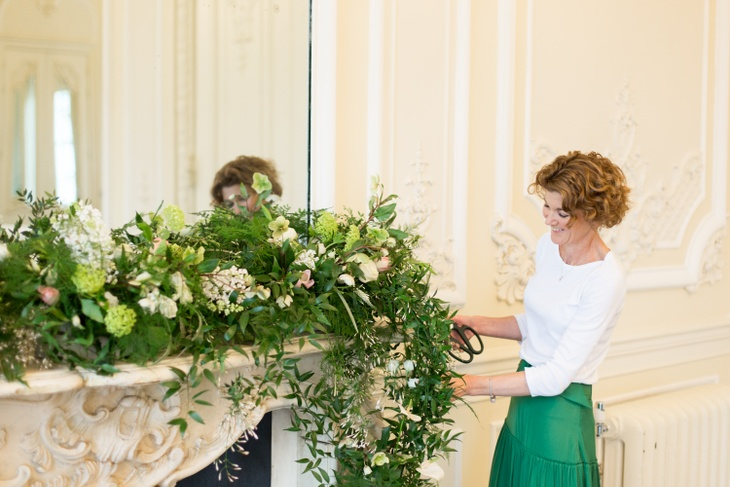 Woman arranging flowers at a central London wedding venue