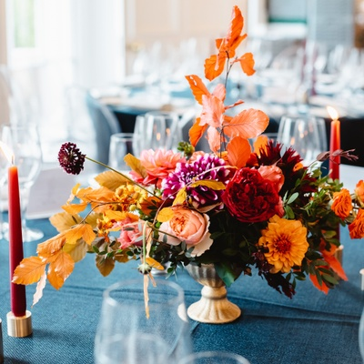 Autumnal wedding flowers on a dinner table