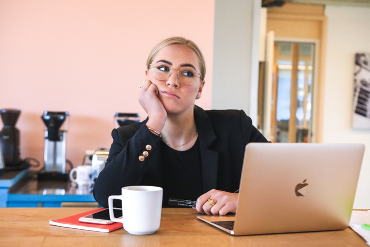 A women attending an online event looking bored