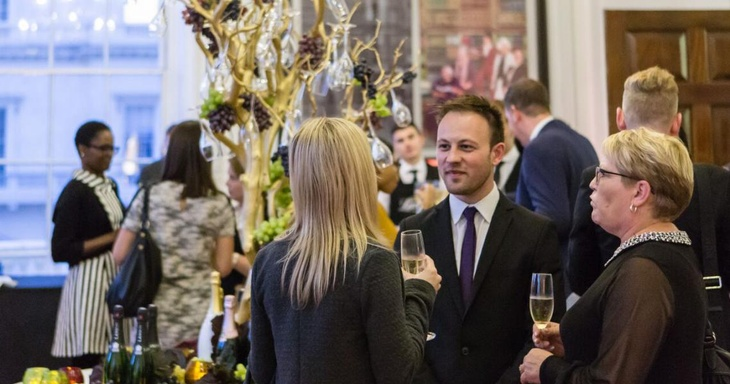 Guests networking at an event at a historic London venue