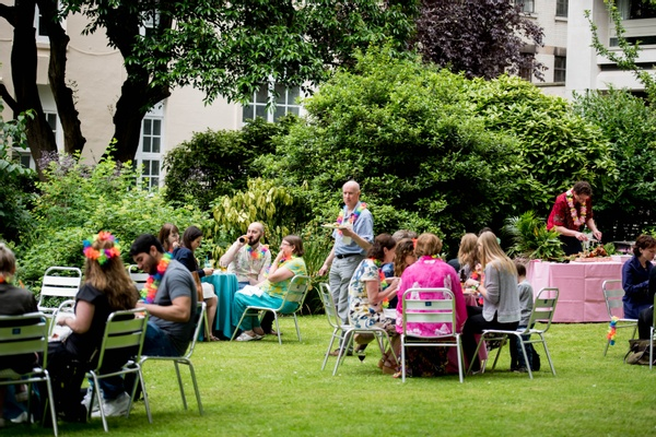 Guests eating in the garden at a summer party venue London