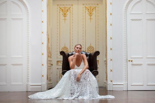 Women wearing wedding gown sat in a luxury London wedding venue