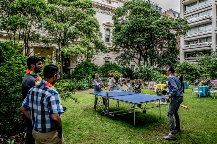 People playing ping pong at garden summer party venue in London, 10-11 Carlton House Terrace