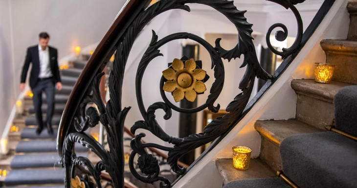 A sweeping staircases inside luxury party venue 10-11 Carlton House Terrace