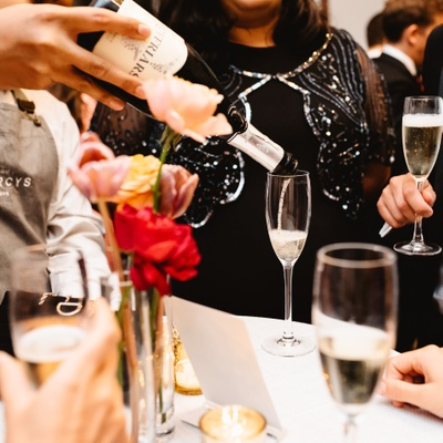 Champagne being served at a wedding guests by London caterer Searcys