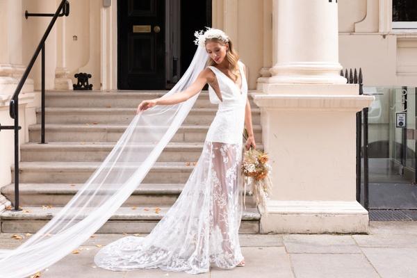 Bride stood outside of small wedding venue London Carlton House Terrace