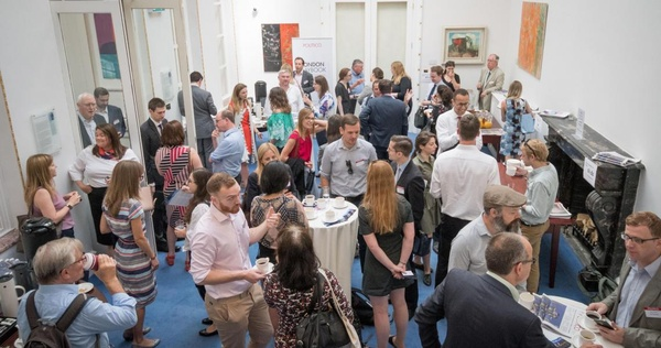 Guests networking at a conference at central London venue, 10-11 Carlton House Terrace