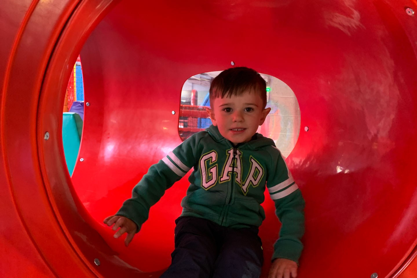 Little Boy Sits in the Crawl Tube at Airtastic Soft Play Centre in Bangor