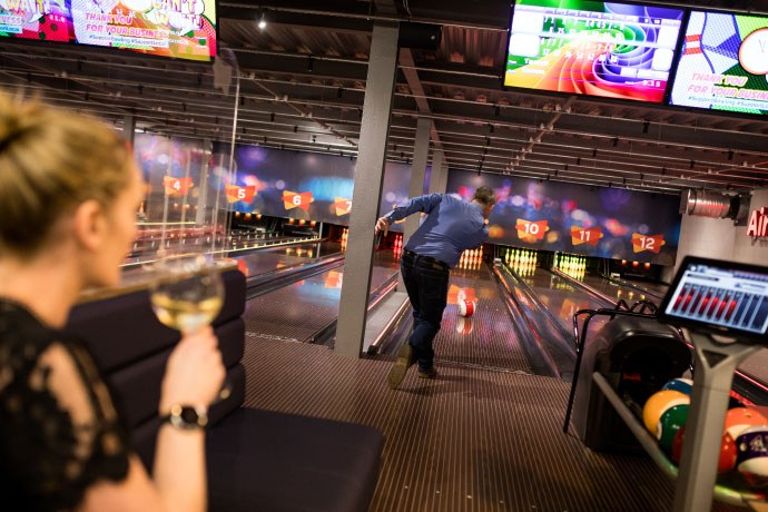 Women Drinking Wine While Man Bowls at Airtastic