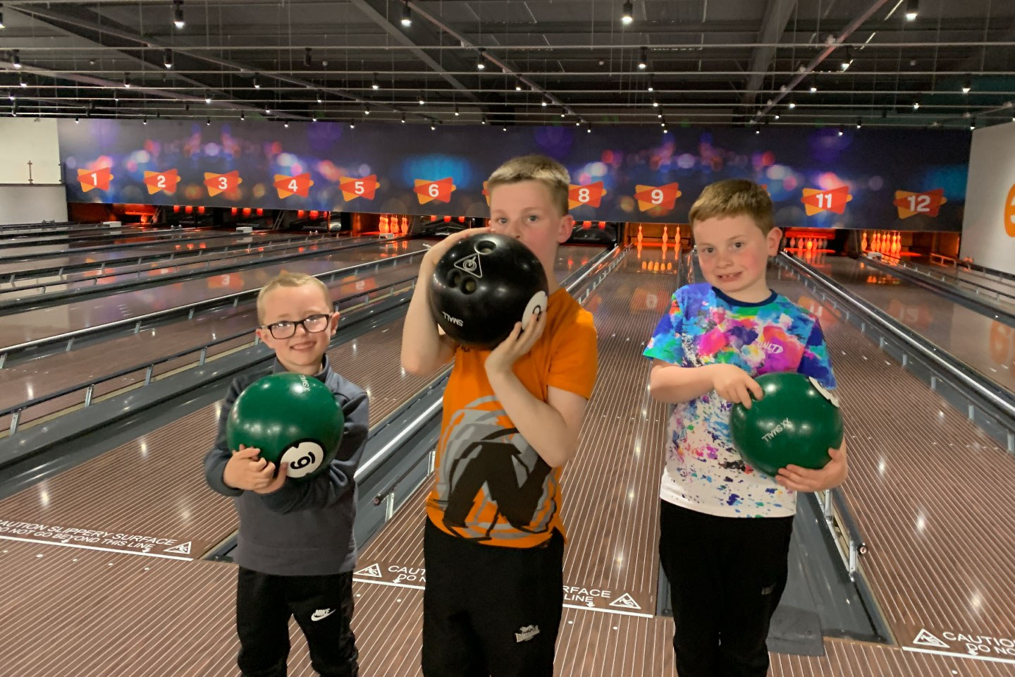 3 Boys Holding Bowling Balls at Airtastic Bowling Alley in Craigavon