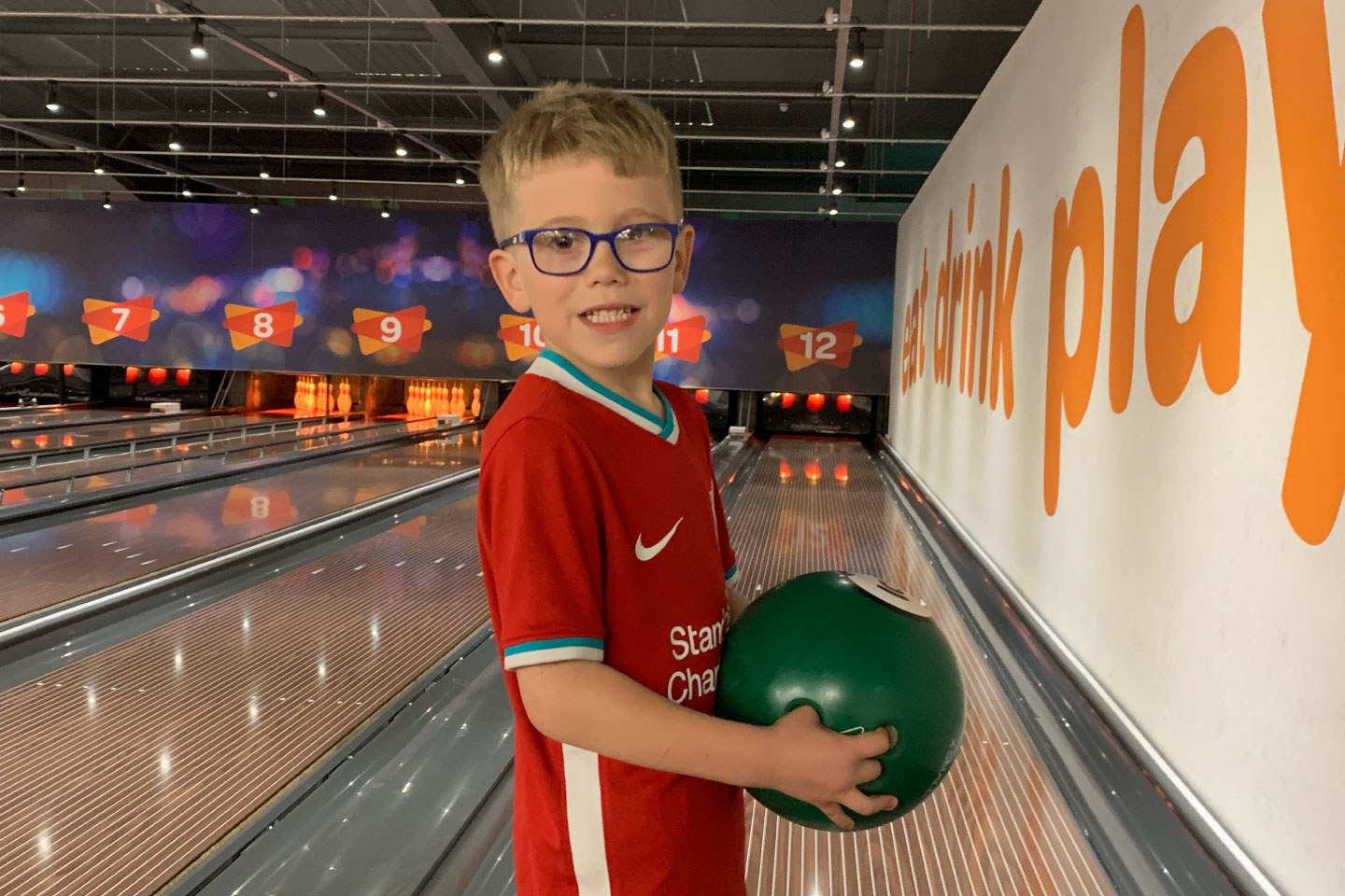 Little Boys Smiling and Holding Bowling Ball At Airtastic Craigavon