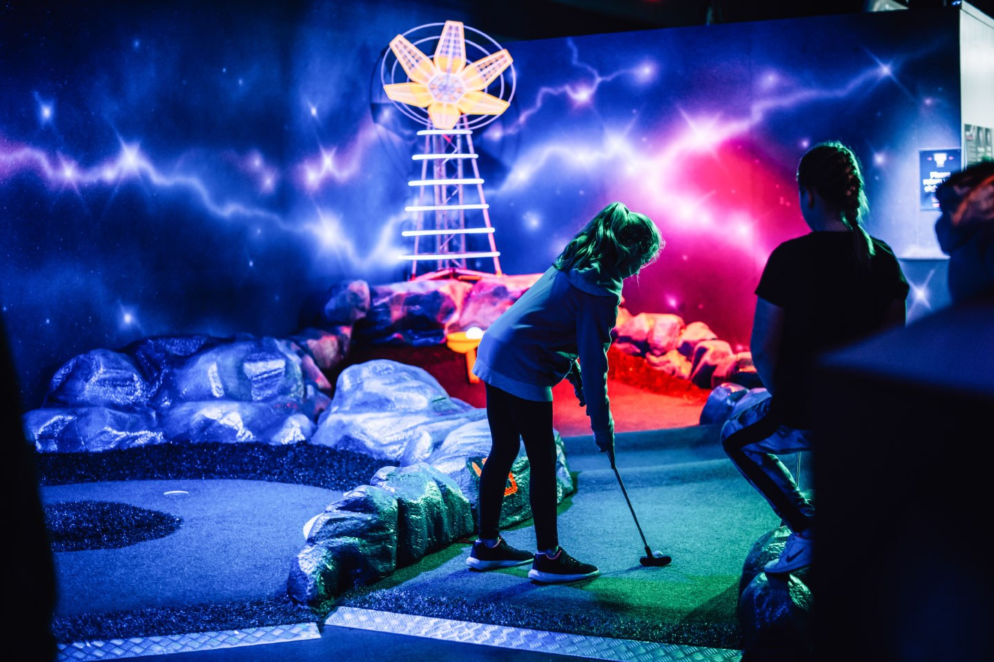 Two Girl Playing Mini Golf at Airtastic Craigavon Adventure Golf Course