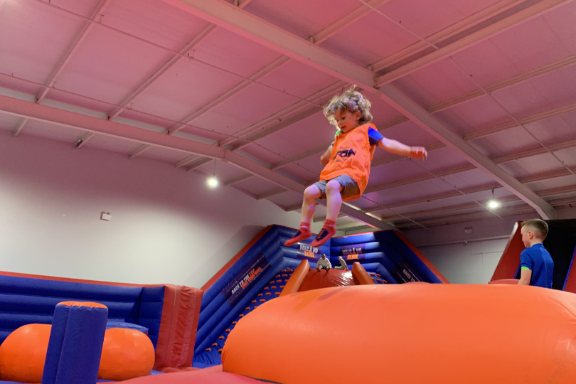 Little Boy Jumps On Jelly Mountain At Airtastic Inflata Park in Newtownabbey