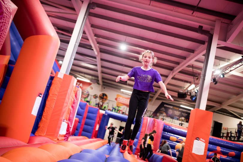 Girl Bouncing at the Airtastic Inflata Park in Newtownabbey