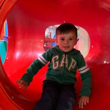 Little Boy Sits in the Crawl Tube at Airtastic Soft Play Centre in Craigavon