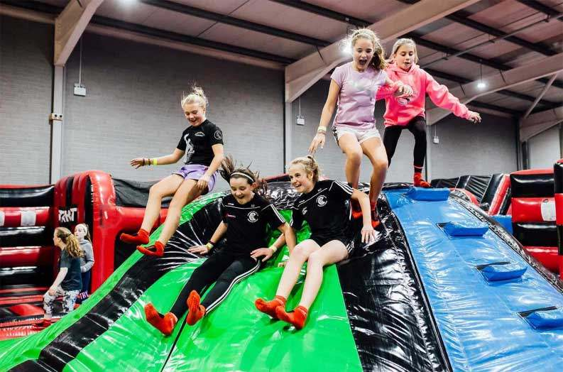 5 girls on top of airtastic inflatable jelly mountain