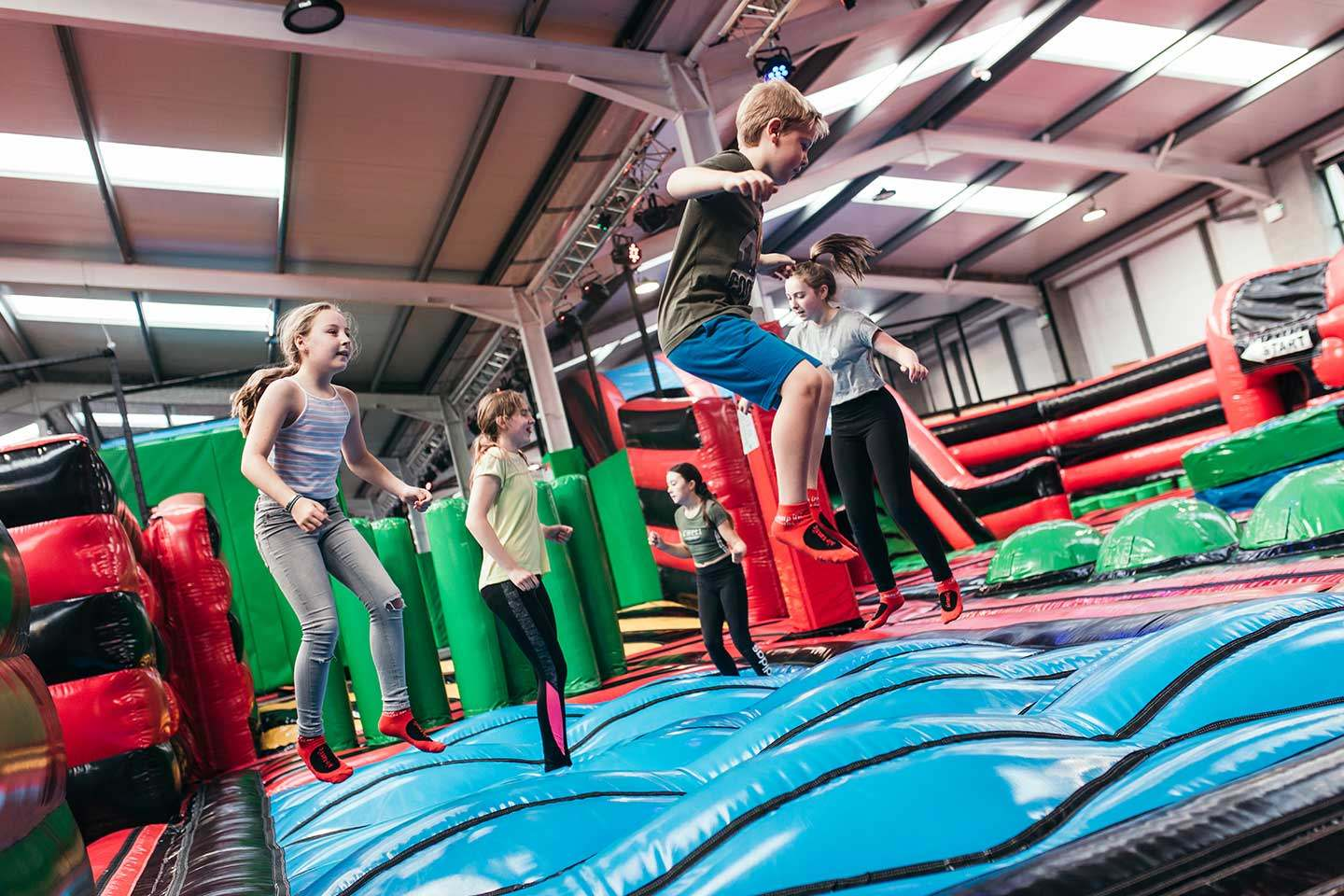 5 children bouncing in Airtastic inflatable park