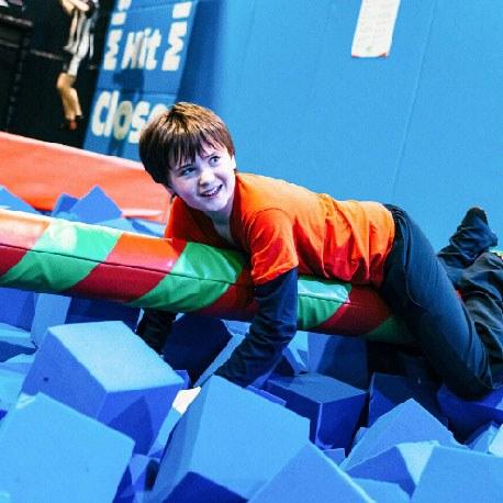 Boy clinging onto Airtastic Balance Beam