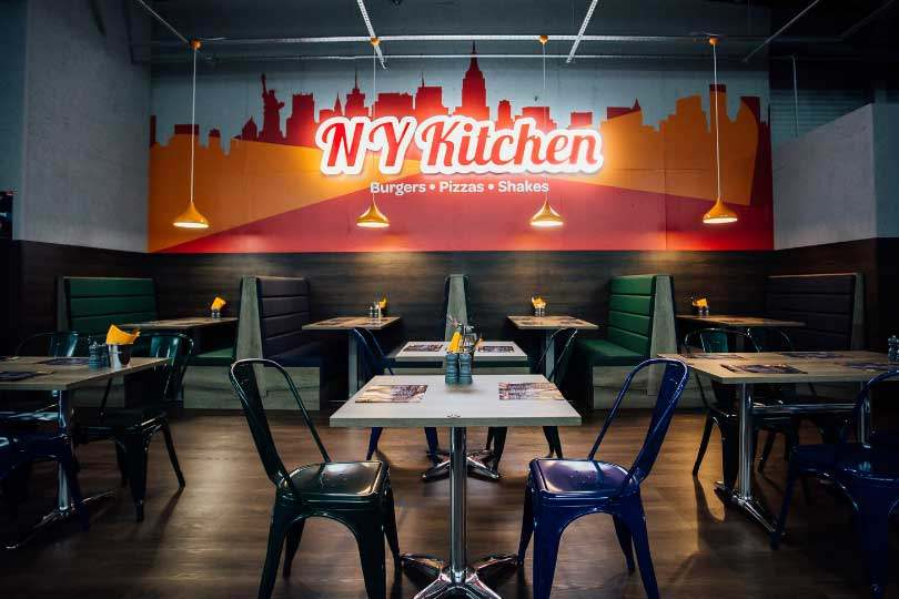 Ny Kitchen Sign and diner style tables