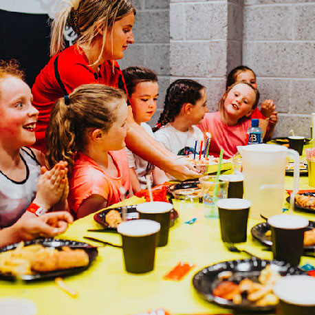 Kids enjoying chicken goujons and chips at Airtastic Birthday Party