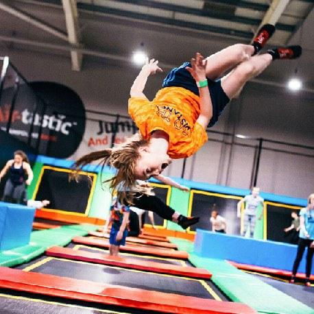 Girl Doing Flip on Airtastic Trampoline
