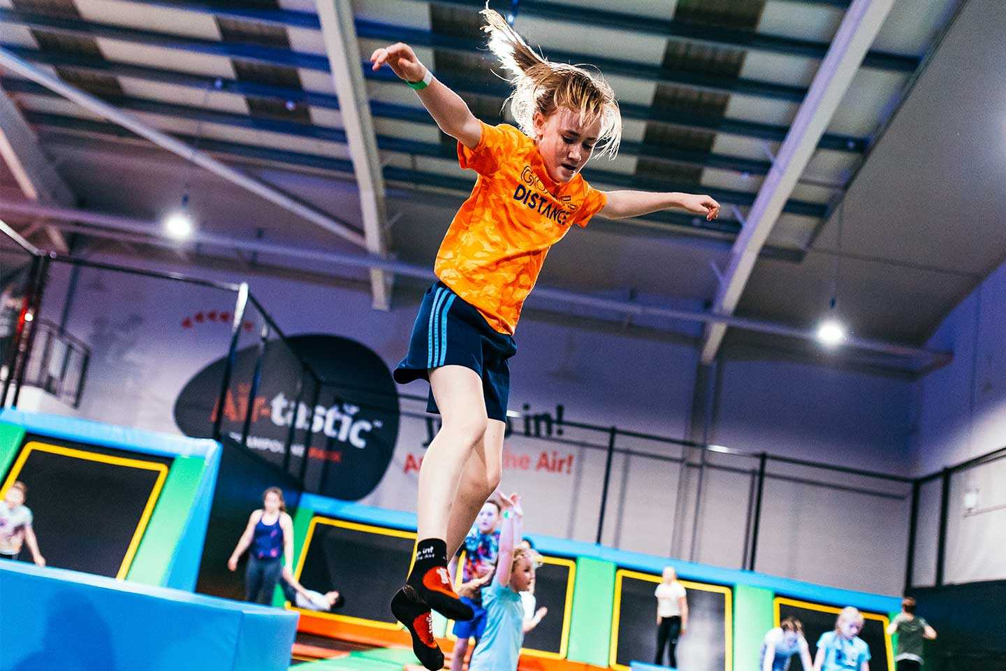 Girl Bouncing high in the air at Airtastic Trampoline Park