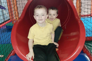Two boys on Airtastic Soft Play Slide