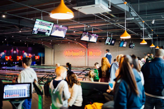 Airtastic Bowling Alley full with people laughing and smiling