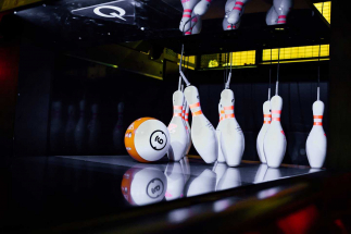 Ball knocking down bowling pins at Airtastic Bowling Alley