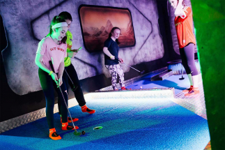 Two girls tapping in final shots at Airtastic Mini Golf Cork