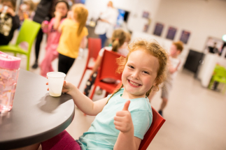 Little Girl Enjoy Drink At Airtastic Soft Play Cafe