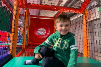 Little Boy Sits in Soft Play Frame At Airtastic Soft Play Centre
