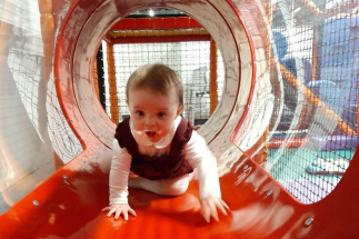 Toddler crawling through tunnel at Airtastic Soft Play