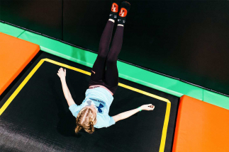 girl landing on  trampoline