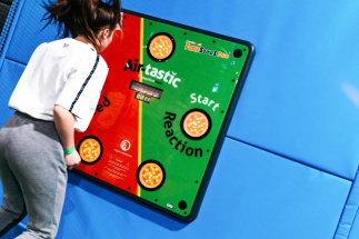 Lady playing Airtastic Bouncing Interactive Games