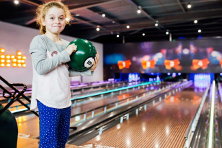 Girl holding ball at Airtastic Bowling Alley