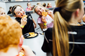 2 girls enjoying Pizza at an Airtastic Birthday Party