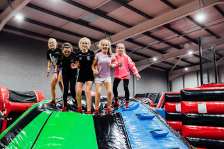 5 girls on top of Airtastic Inflata Jelly Mountain