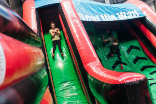 Children Enjoying Beat the Wall at Airtastic Inflata Park