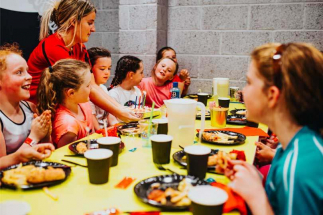 Kids enjoying chicken goujons and chips in Airtastic Party Room