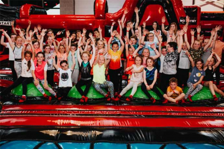 School Group pose for a Photo at Airtastic Inflata Park