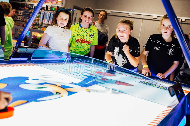 Group of Girls playing Air Hockey at Airtastic Amusement Arcade