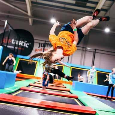 Girl doing somersault at Airtastic Trampoline Park