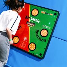 Girl playing an interactive challenge