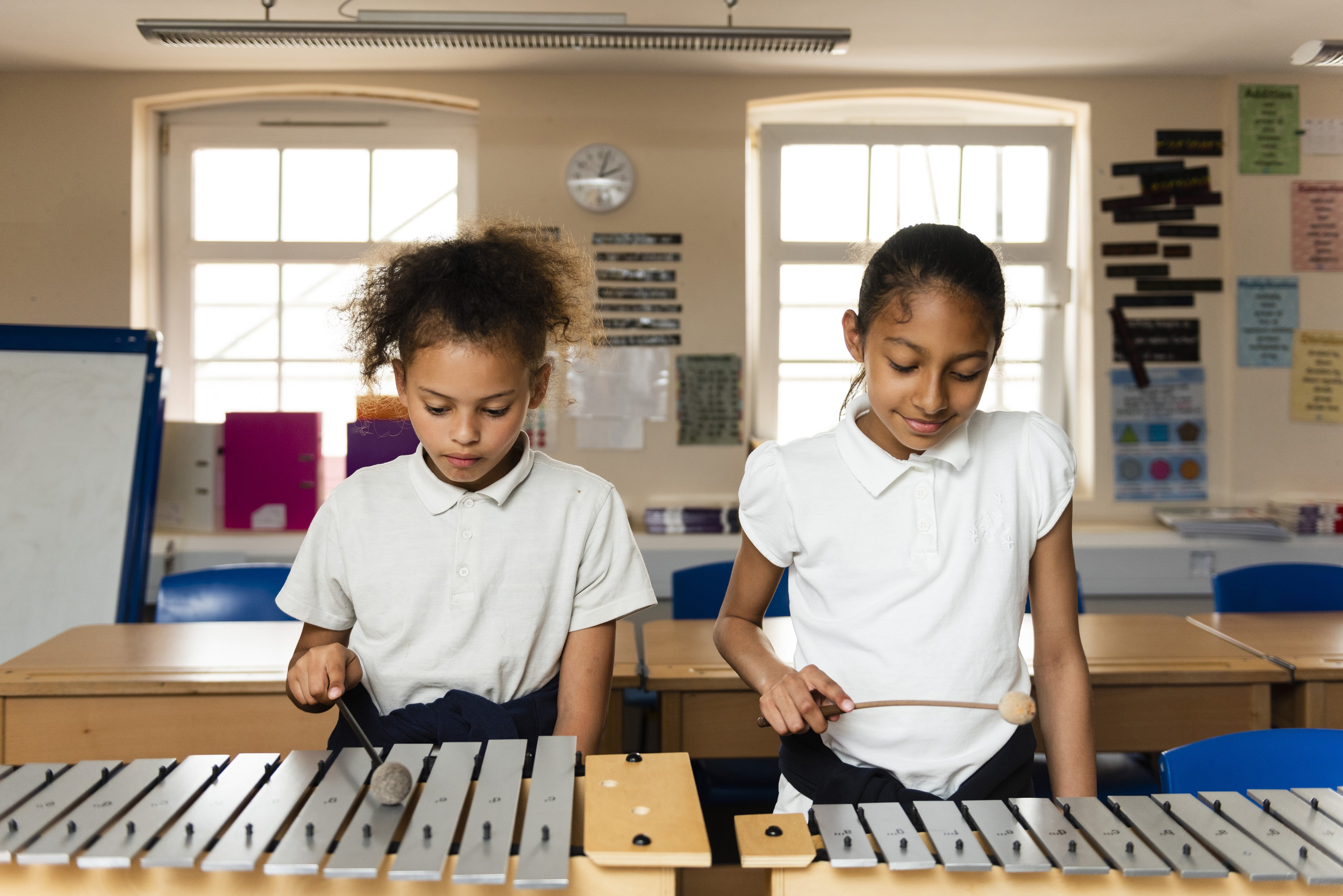 Randal Cremer_two children playing with xylophone